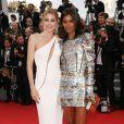 Doutzen Kroes et Liya Kebede sur les marches du Palais des Festivals pour la projection du film La Tête Haute et la cérémonie d'ouverture du 68e Festival de Cannes. Cannes, le 13 mai 2015.