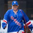 Exclusif - Rebel Wilson rentre à son hôtel avec un mystérieux inconnu, après avoir assisté à un match des Rangers à New York. Le 16 mai 2015