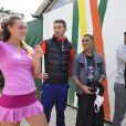 Clothilde de Bernardi et son compagnon Brahim Asloum après son second tour des qualifications de Roland-Garros, le 21 mai 2015 à Paris