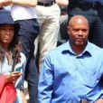 Maurice Greene et sa compagne lors du tournoi de tennis de Roland-Garros à Paris le 3 juin 2015