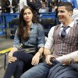Cristiano Ronaldo et sa compagne Irina Shayk lors du match d'Euroleague entre le Real Madrid et le CSK Moscou le 20 mars 2014 à Madrid