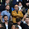 M. Pokora, Pascal Obispo et sa compagne Julie Hantson au Stade de France pour la rencontre France - Belgique à Saint-Denis le 7 juin 2015