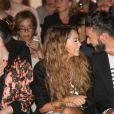 Nabilla Benattia et son compagnon Thomas Vergara lors du défilé Jean Paul Gaultier collection Haute Couture Automne-Hiver 2014/2015 au showroom Jean Paul Gaultier à Paris, le 9 juillet 2014