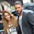 Nabilla Benattia et Thomas Vergara lors de leur arrivée au défilé Jean Paul Gaultier au showroom Jean Paul Gaultier à Paris le 9 juillet 2014