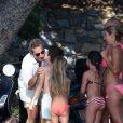 Exclusif : Nicolas Sarkozy, sa femme Carla Bruni-Sarkozy et leur fille Giulia sont sur la plage de Cavalière au pied de leur résidence du Cap Nègre, le 14 juillet 2014, pendant leurs vacances.