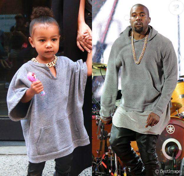 Grosse chaîne, pull gris, pantalon et chaussures noirs : Kanye (photographié en concert à New York en décembre 2014) et North West (2 ans) ont le même style !