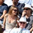 Laura Smet et son compagnon Raphaël dans les tribunes lors du tournoi de tennis de Roland Garros à Paris le 3 juin 2015.03/06/2015 - Paris
