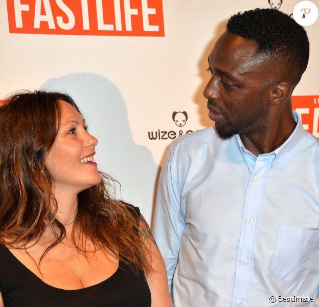 """Thomas Ngijol et sa compagne Karole Rocher - Avant-première du film """"Fastlife"""" au cinéma Gaumont Capucines Opéra à Paris, le 15 juillet 2014."""