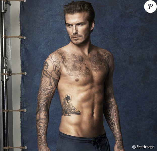 David Beckham montre ses tatouages en présentant la ligne de maillots homme de la marque H&M.