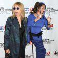 """Rosanna Arquette et Alexis Arquette lors de l'ouverture du festival du film indien 2014 avec la projection du film """"Sold"""" aux ArcLight Cinemas à Hollywood, le 8 avril 2014. L'actrice transgenre est morte à 47 ans le 11 septembre 2016."""