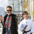 """Clotilde Courau arrivant au défilé de mode """"Elie Saab"""", collection prêt-à-porter Printemps-Eté 2017 à Paris, le 1er octobre 2016"""