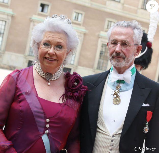 La princesse Christina de Suède et son époux Tord Magnuson au mariage de Carl Philip de Suède et Sofia Hellqvist à la chapelle du palais royal à Stockholm le 13 juin 2015