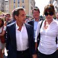 """Nicolas Sarkozy avec sa femme Carla Bruni-Sarkozy, Maud Fontenoy, et le député maire de Nice, Christian Estrosi sont dans les rues de Nice après avoir déjeuné au restaurant """"La Petite Maison"""" et avant de rencontrer les élus et les militants du parti Les Républicains au jardin Albert 1er le 19 juillet 2015."""