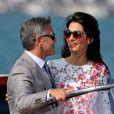 George Clooney et Amal Alamuddin apparaissent pour la première fois après leur mariage, le 28 septembre 2014, quittant l'Aman Grande Canal Venice après leur nuit de noces pour rallier le Cipriani pour un brunch avec leurs proches.