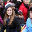 Les Princesses Beatrice et Eugenie à la sortie de la messe de Noël de la famille royale UK