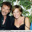 Johnny Hallyday et Laura Smet lors de la soirée d'inauguration de l'Amnésia, le 1er octobre 2003.