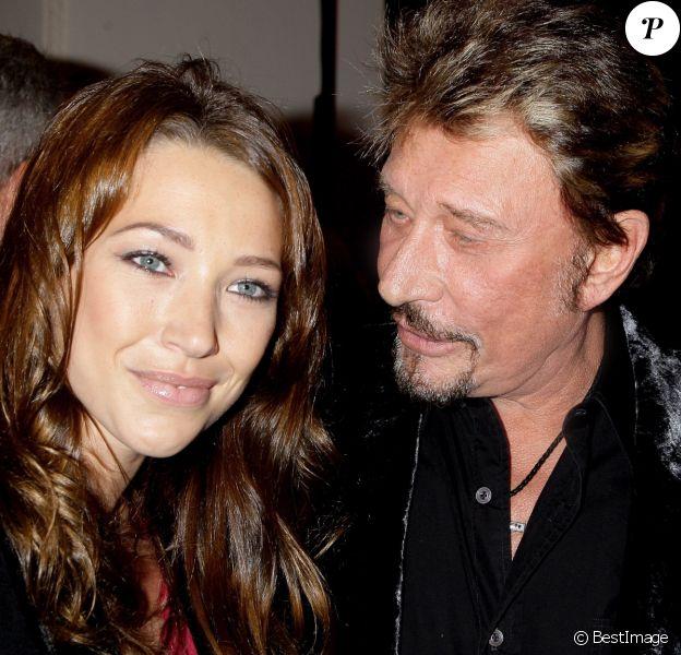 """Laura Smet et Johnny Hallyday au vernissage de l'exposition """"Images et mode"""" du photographe Patrick Demarchelier au Petit Palais, à Paris, le 29 septembre 2008."""