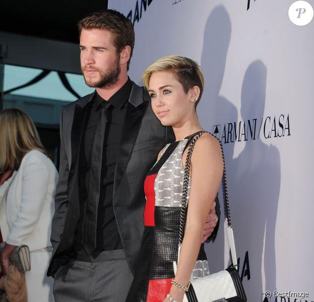"""Liam Hemsworth et Miley Cyrus - Première du film """"Paranoia"""" à Los Angeles, le 8 aout 2013."""