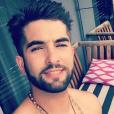 Kendji passe du bon temps à Miami. Quand il ne bronze pas, il se fait tatouer. Avril 2017.