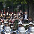 """Emmanuel Macron (costume """"Jonas & Cie"""" (rue d'Aboukir à Paris) à 450 Euros) salue les français sur l'avenue des Champs Elysées à Paris le 14 Mai 2017."""