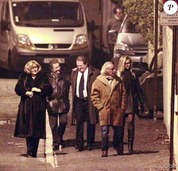 La compagne de Christian Clavier, Christian Clavier, Didier Barbelivien et sa compagne, à l'anniversaire de Nicolas Sarkozy