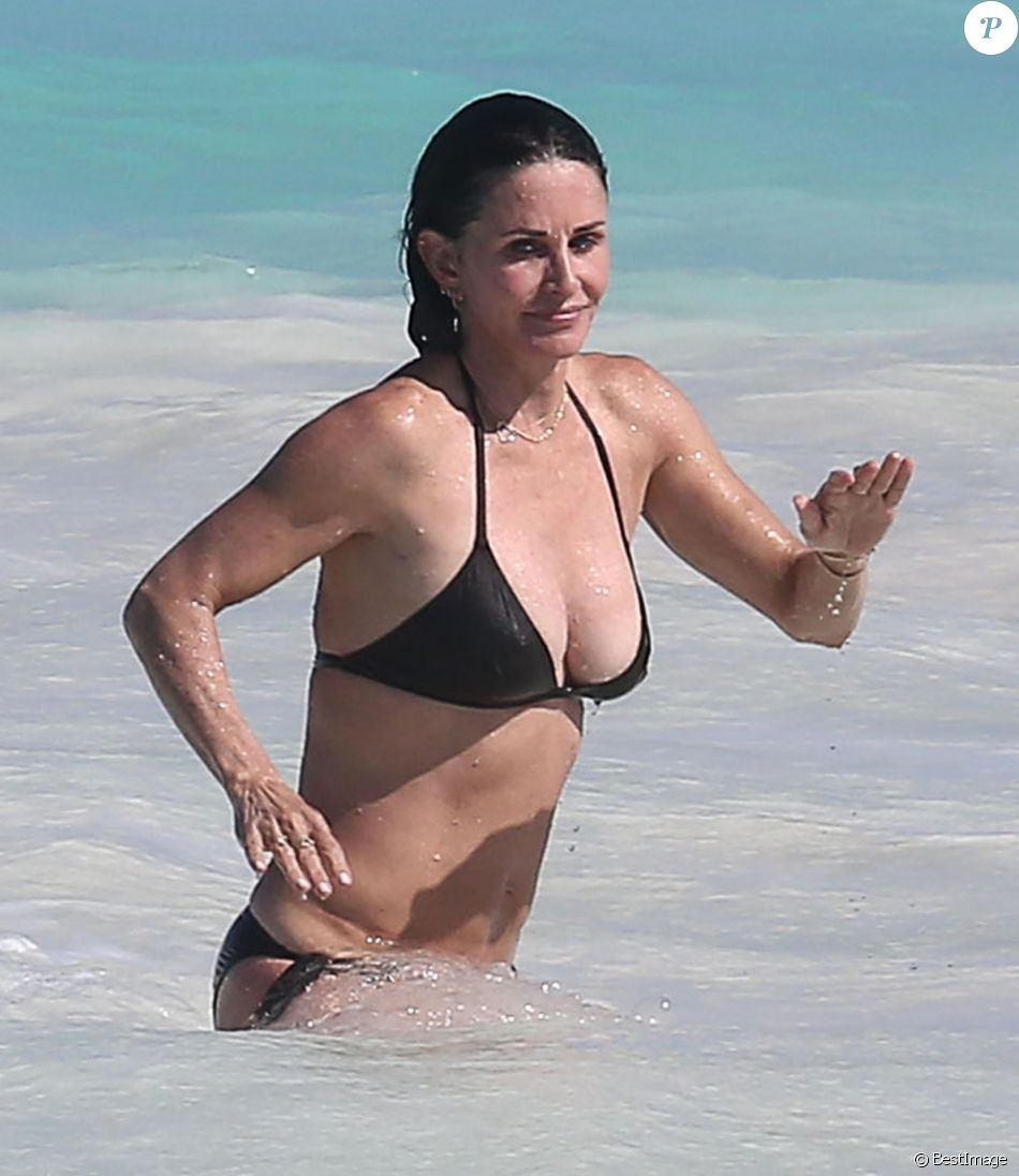 Courteney cox in a bikini vacationing in miami