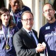 Francois Hollande et Yohann Diniz médaille d'or du 50km marche - L'équipe de France d'athlétisme a été reçue à l'Elysée par François Hollande et Najat Vallaud-Belkacem, le 18 août 2014.