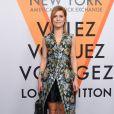 """Marina Foïs assiste au vernissage de l'exposition """"Volez, Voguez, Voyagez"""" de Louis Vuitton à l'American Stock Exchange. New York, le 26 octobre 2017."""