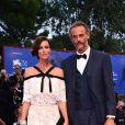 Anna Mouglalis et son ami musicien arrivent à la cérémonie de clôture du 74e Festival International du Film de Venise (Mostra), le 9 septembre 2017.