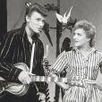 """Johnny Hallyday, Line RENAUD et Aimée Mortimer sur le plateau de l'émission """"L'école des Vedettes"""". Le 6 avril 1960 © Bernard Roger via Bestimage"""