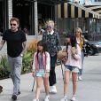 Johnny Hallyday, souriant sort déjeuner en famille au Water Grill de Santa Monica le 18 mars 2017 pour l'anniversaire de Laeticia qui fête le jour même ses 42 ans.