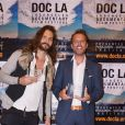 """Didier Beringuer (à gauche), réalisateur de VIF - Fabrice Sopoglian reçoit deux Awards pour le documentaire """"VIF"""" sur la vie de Christian Audigier lors du festival DOC LA à Los Angeles le 20 octobre 2017."""