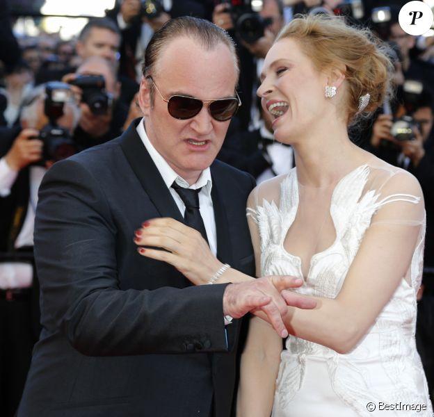 """Quentin Tarantino et Uma Thurman - Montée des marches du film """"Pour une poignée de dollars"""" pour la cérémonie de clôture du 67e Festival du film de Cannes – Cannes le 24 mai 2014"""
