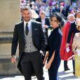 David Beckham et sa femme Victoria arrivent à la chapelle St George pour le mariage du prince Harry et de Meghan Markle au château de Windsor, Royaume Uni, le 19 mai 2018.