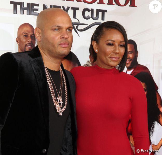 """Melanie Brown (Mel B) et son mari Stephen Belafonte lors de la première de """"BarberShop: The Next Cut"""" à Hollywood, le 6 avril 2016."""
