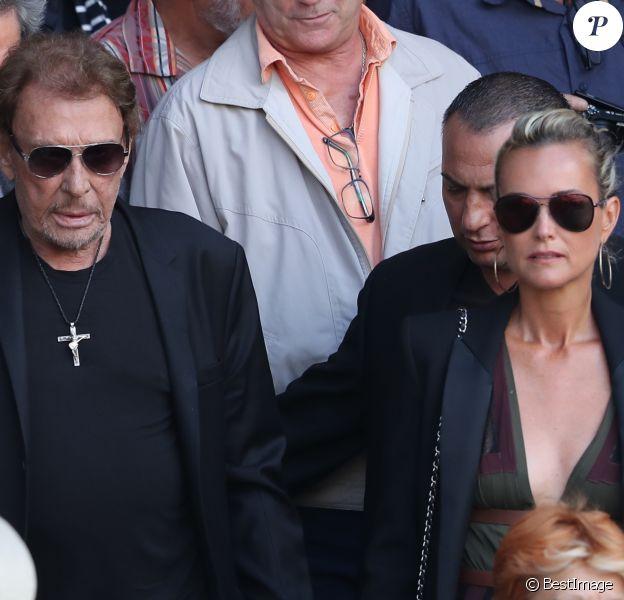 Johnny et Laeticia Hallyday aux obsèques de Mireille Darc en l'église Saint-Sulpice à Paris. Le 1er septembre 2017.