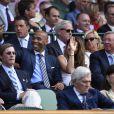 Thierry Henry et sa compagne enceinte Andrea Rajacic lors des demi-finales hommes du tournoi de Wimbledon au All England Lawn Tennis and Croquet Club, à Londres le 10 juillet 2015