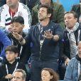 Patrick Bruel et son fils - Célébrités dans les tribunes lors de la demi-finale de la coupe du monde opposant la France à la Belgique à Saint-Pétersbourg, Russie, le 10 juillet 2018. La France a gagné 1-0. © Cyril Moreau/Bestimage