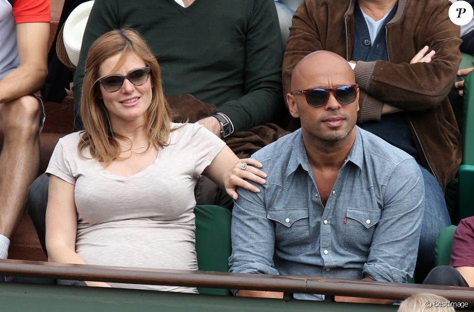 Eric Judor et sa compagne (enceinte) aux Internationaux de France de tennis de Roland Garros à Paris, le 29 mai 2014.