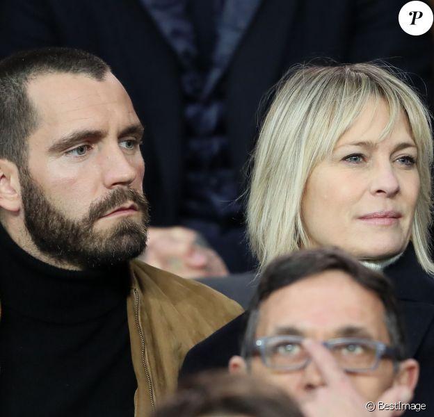 Robin Wright et Clément Giraudet assistent aux huitièmes de finale retour de Ligue des Champion, du Paris Saint-Germain contre le Real Madrid au Parc des Princes à Paris le 6 mars 2018. © Cyril Moreau/Bestimage