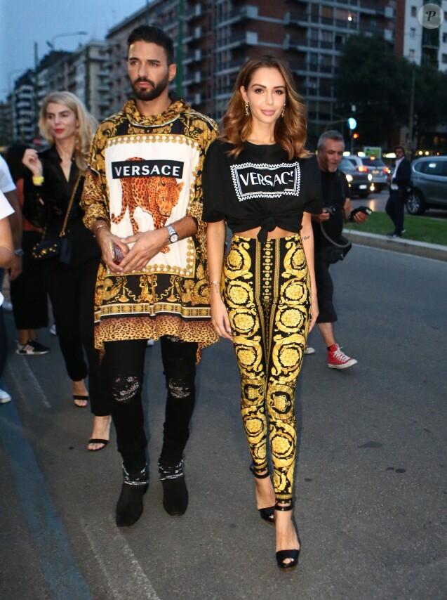 """Nabilla Benattia et Thomas Vergara au défilé Versace - Collection Prêt-à-Porter Printemps/Eté 2019"""" lors de la Fashion Week de Milan (MLFW) le 21 septembre 2018."""