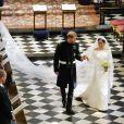 Meghan Markle, duchesse de Sussex, dans sa robe de mariée Givenchy réalisée par Clare Waight Keller, et le prince Harry lors de leur mariage à Windsor le 19 mai 2018.