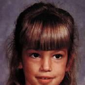 Regardez-moi à l'âge de 8 ans... Qui suis-je ?