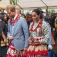 Le prince Harry et la duchesse Meghan de Sussex, enceinte, lors de leur visite dans le royaume des Tonga le 26 octobre 2018.