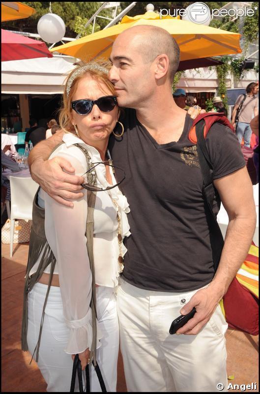Rosanna Arquette et Jean-Marc Barr à la plage Vitamin Water à Cannes le 18 mai 2009