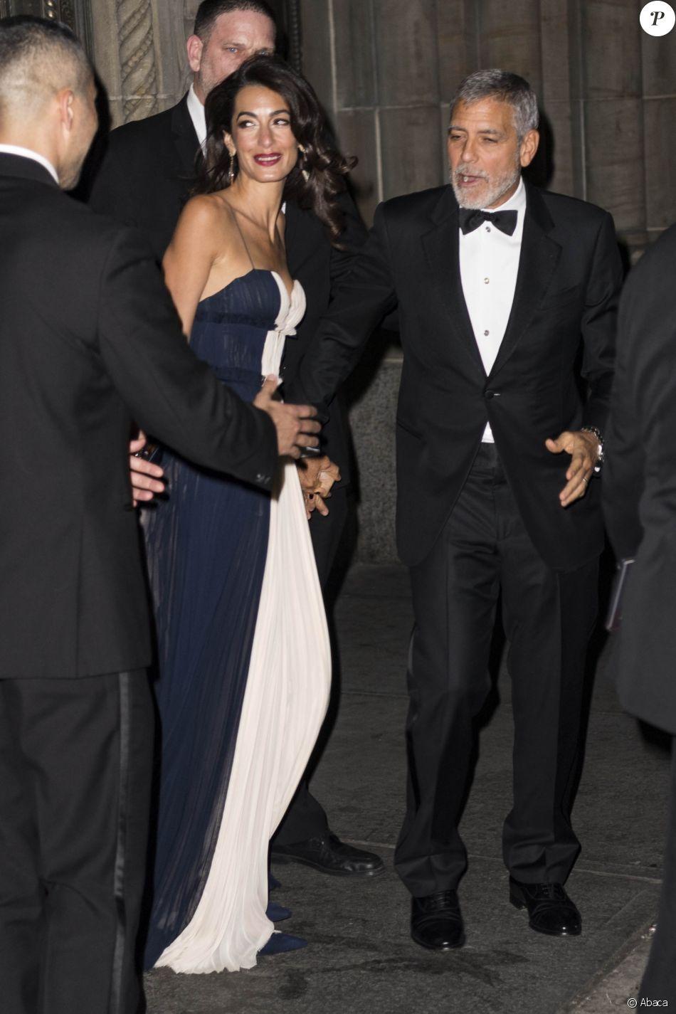 Amal Clooney et George Clooney à la sortie du dîner United Nations Correspondence Association au Cipriani à New York, le 5 décembre 2018.