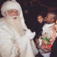 Kim Kardashian, son mari Kanye West et leur fille North West rencontrent le Père Noël. Décembre 2015.