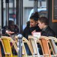 Exclusif - Bilal Hassani (qui va représenter la France à l'Eurovision) au naturel, sans sa perruque de scène, prend un verre en terrasse avec des amis à Paris le 18 janvier 2019.