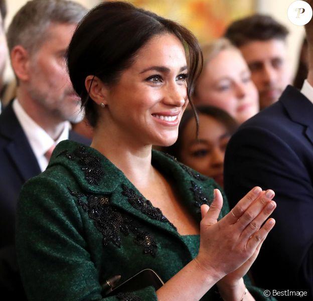 Meghan Markle, enceinte, duchesse de Sussex, lors de sa visite à Canada House dans le cadre d'une cérémonie pour la Journée du Commonwealth à Londres le 11 mars 2019.