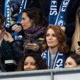 Alessandra Sublet et un ami, Maëva Coucke (Miss France 2018), Flora Coquerel (Miss France 2014) - People assistent au match des éliminatoires de l'Euro 2020 entre la France et l'Islande au Stade de France à Saint-Denis le 25 mars 2019. La france a remporté le match sur le score de 4-0.